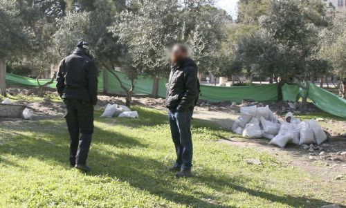 . A Policeman and IAA archaeologist supervising the construction work