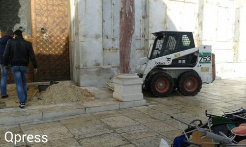 "This photograph was taken outside of the Dome of the Rock by the east door at the same time as the above photographs. It raises the question of why a small tractor and piles of sand were needed to ""replace the carpet.""  Visitors to the Temple Mount also reported seeing paving tiles being carried into the building.  This kind of work should have been done under close supervision of preservation experts from the IAA."